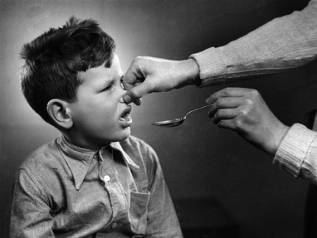 Marius Meijboom | Boy gets a spoon of cod liver oil